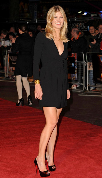 Rosamund Pike looks leggy in a pair of deep burgundy Christian Louboutin peep-toes. The platforms paired perfectly with a simple long sleeved LBD.