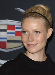 Gwyneth donned a skinny black headband with her retro chic updo at the Women in Hollywood event.