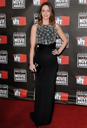 Emily Blunt showed off her long and lean figure with this black column dress that featured a fully beaded bodice and a bow detail at the waist.