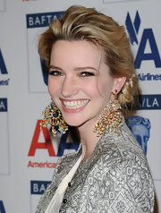 Talulah highlighted her classic chignon with decorative dangle earrings.