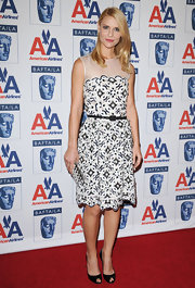 Claire kept things classic in her black-and-white printed dress. She paired her day dress with peep-toe black pumps.