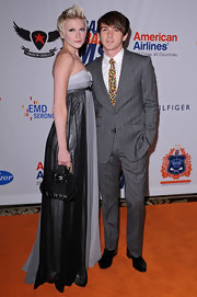 Drake Bell was looking slick in this grey pinstripe suit.