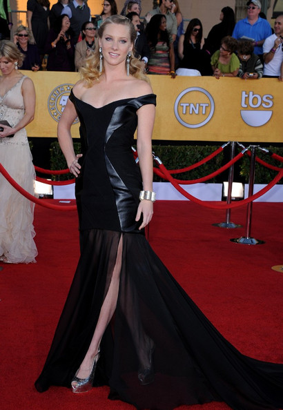 Heather Morris is amazing.  Her puzzling one-liners from Glee are only outmatched by her fashion sense. To wit: This evening's head-scratching gown. We love the off-the-shoulder elegance and train of chiffon, but everything in between (tell us that's not pleather!) is simply befuddling.