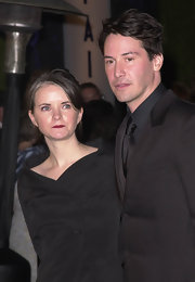 Here, Keanu wore his hair in a feathered side-part.