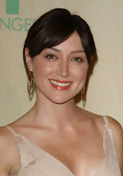 Sasha Alexander opted for a simple look at the Crystal & Lucy Awards with her brunette locks in an unfussy bun.