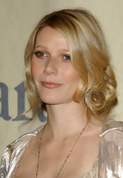 Gwyneth Paltrow epitomized romantic elegance with a side swept curled updo.