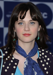 Zooey Deschanel accessorized her look with a pair of silver dangle earrings with sea green beads.