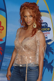 Tyra's top at the Teen Choice Awards was both elegant and sexy with its shiny sheer fabric.