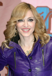 Madonna was all smiles at the MTV Music Awards in Europe. She topped off her purple leather jacket with a few bouncy curls.