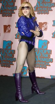 Superstar model showed off her love of purple in a pair of lace-up knee-high boots at the MTV Europe Awards.