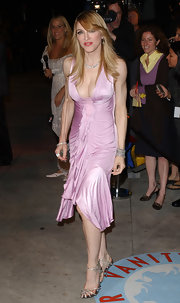 Madonna looked fierce in a slinky pink cocktail dress for the Vanity Fair Oscar party.