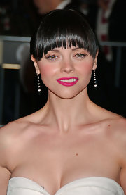 Dressed in Calvin Klein she wears black and white earrings the look great with her sleek sultry look.