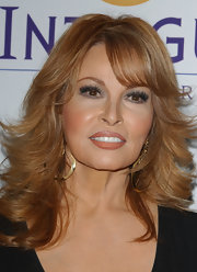 Raquel Welch opted for a coral shade of lipstick at the Clive Davis Pre-Grammy party.