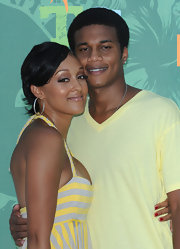 Tia Mowry paired her summer dress with simple gold hoop earrings.