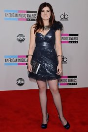 Madison Cain added shine to her metallic cocktail dress with navy blue satin pumps.