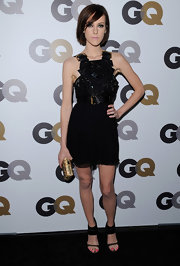 Actress Jena Malone arrived on the red carpet for the 2010 GQ Men of the Year Party wearing a gold Swarovski crystal box clutch.