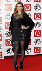 Charlotte Church finished her mesh-detail dress with a pair of towering black ankle boots.