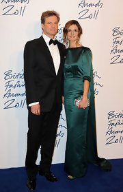 livia Giuggioli channeled Jackie O at the British Fashion Awards in an emerald taffeta evening gown with a long train.