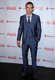 Ryan Reynolds looked sharp in his three piece navy blue suit. He paired his look with a matching tie.