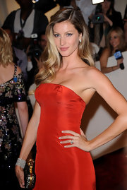 Gisele topped off her red hot gown at the Met Gala with sideswept curls a la Old Hollywood glamor.