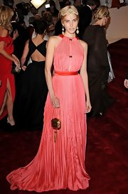 Isabel went for a dramatic look in salmon chiffon evening gown and Egyptian accessories for the Met Costume Gala.