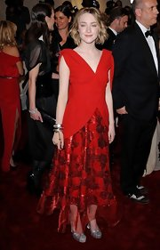 Saoirse Ronan wore a very costumey cocktail dress in a vibrant red for the Met Costume Gala.