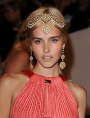 Isabel Lucas channeled an Indian princess with a beaded headpiece at the Met Gala.