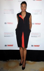 Aisha Tyler's red and black two-tone dress was minimal yet dramatic.