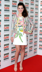 Celine Buckens complemented her colorful dress and jacket combo with neutral platform sandals.