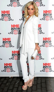Rita Ora topped off her look with platform nude peep-toe pumps.