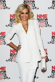 Rita Ora accessorized her white hot MME Awards look with a matching studded clutch.
