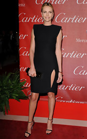 Charlize Theron looked unbelievable in a crisp black cocktail dress at the Palm Springs International Film Festival.