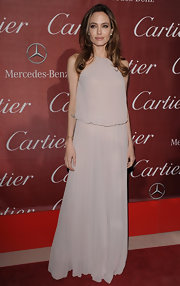 Angelina Jolie wore a drop-waist Grecian gown for the Palm Springs International Film Festival.