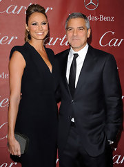 Stacy Keibler added shimmer to her sophisticated black dress with a glittery hard case clutch.