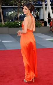 Victoria bid adieu to summer in this backless orange silk gown at the Creative Arts Emmy Awards.