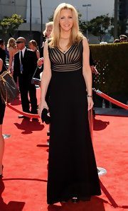Lisa Kudrow went for subdued elegance at the 2012 Primetime Emmys in a black evening dress featuring a sheer-illusion striped bodice.