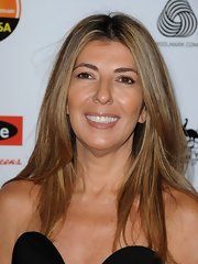 Nina Garcia wore a sleek center-parted hairstyle at the 2013 G'Day USA Black Tie Gala.
