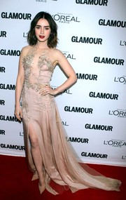 Lily Collins channeled her inner goddess in this stunning embellished nude gown by Julien Macdonald at the Glamour Women of the Year Awards.