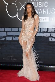 Ciara sparkled when she wore this nude-colored gown with crystal embroidery and a feathered hem.