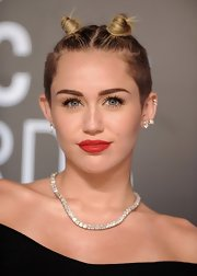 Miley went with an old-school style when she opted for a tiny pair of hair knots.