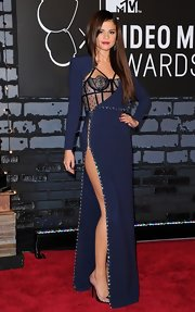 Selena's peek-a-boo dress was classy yet sexy on the red carpet.