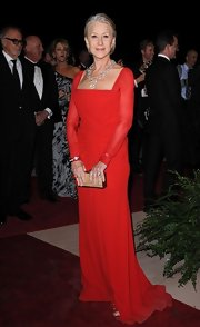 Helen Mirren looked positively regal in this red draped gown with a square neckline and sheer sleeves.