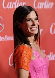 Sandra Bullock left her hair down in sleek straight layers when she attended the Palm Springs International Film Festival.