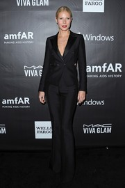 Gwyneth Paltrow looked flawlessly chic at the amfAR Inspiration LA Gala in a black Tom Ford pantsuit with cutout accents.