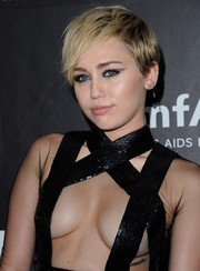 Miley Cyrus teamed a short layered cut with a barely-there dress for her amfAR Inspiration LA Gala look.