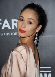 A pair of dangling diamond earrings finished off Cara Santana's look in ultra-glam style.