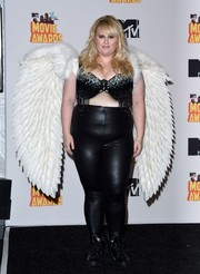 Rebel Wilson changed out of her caped LBD into this bejeweled, fringed bra for the MTV Movie Awards show.