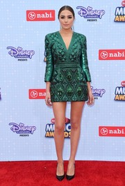 Olivia Culpo put on a leggy display in a quilted green Balmain mini dress during the Radio Disney Music Awards.