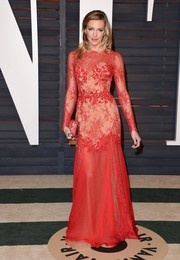 Katie Cassidy looked sultry in a sheer red Zuhair Murad lace gown during the Vanity Fair Oscar party.