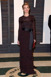 Faith Hill exuded feminine charm at the Vanity Fair Oscar party in a long-sleeve Dolce & Gabbana polka-dot gown with a tiered skirt and a bowed satin sash.